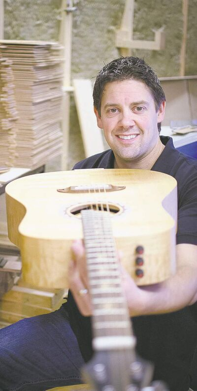 ***FREELANCE PHOTO - POSTMEDIA NETWORK USE ONLY*** KAMLOOPS, BC: JANUARY 9, 2012 -- MIKE MILTIMORE -- Mike Miltimore, Co-owner of Lee's Music, poses for a photograph in the workshop for his new venture, Riversong Guitars. Miltimore developed a guitar manufacturing technique so accurate and automated that he says a tenth grader can do it. Courtesy of Lee's Music. [For story by Danny Bradbury, FP Entrepreneur]