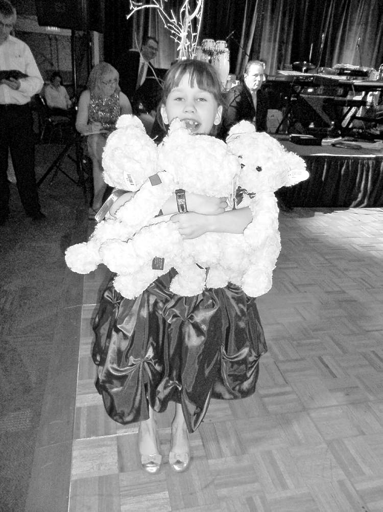 Abby Reid holds an armful of teddy bears at the Juvenile Diabetes Research Foundation's Starry Starry Night Gala.