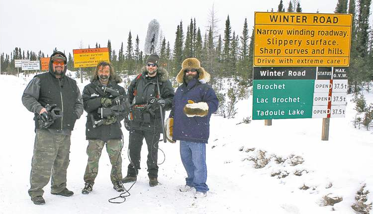 Above, Willy�s 2000 Chevrolet Silverado 2500 HD handled winter roads like a champ. At right (from left), Willy with director of photography Dave Gaudet, lighting technician Kevin Bacon and fellow TV host and friend Jay McLeod at the onset of the winter road to Tadoule Lake.peg Free Press