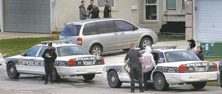 phil hossack / winnipeg free pressA young woman is put into a squad car as police investigate a suspicious death in the 500 block of Island Shore Boulevard.