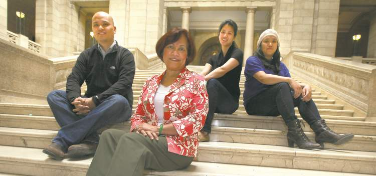Phil Hossack / Winnipeg Free Press Minister of Culture and Heritage Flor Marcelino poses with three of her five kids (from left), Diwa, Malaya and Awit, on the grand staircase at the legislature.