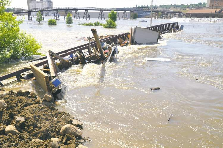 Pedestrian bridge over the Souris River in Minot, N.D. washes out.