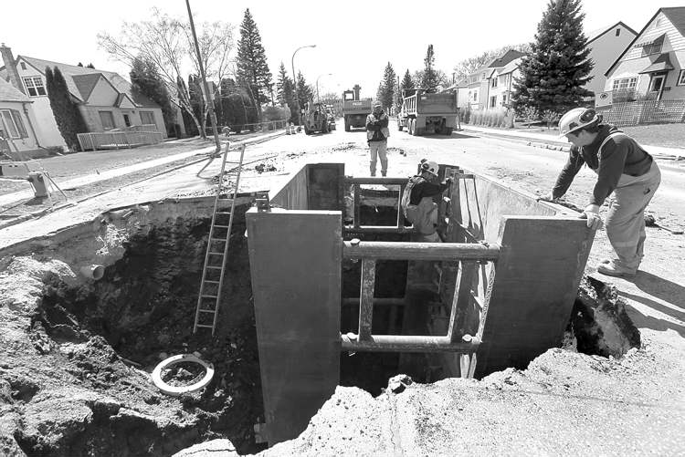 City workers attend to a sinkhole on Corydon Avenue in April.
