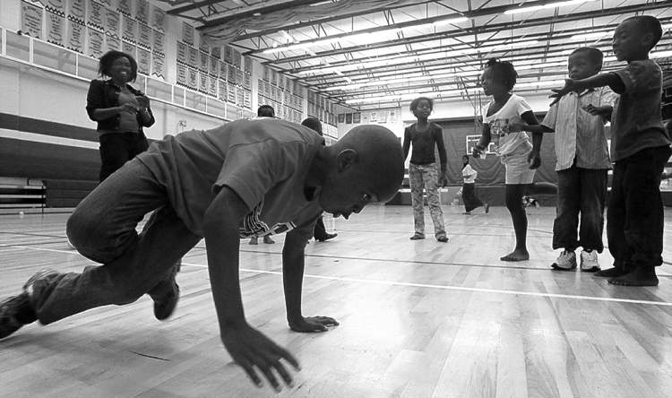 Summer Transitional School for Immigrants - Rodrique Buledi gets down as kids dance during a day camp held by the Fondation Charite Congo-Canada at the College Louis Riel. Carol Sanders story  110726 - Tuesday, July 26, 2011 -  (MIKE DEAL / WINNIPEG FREE PRESS)