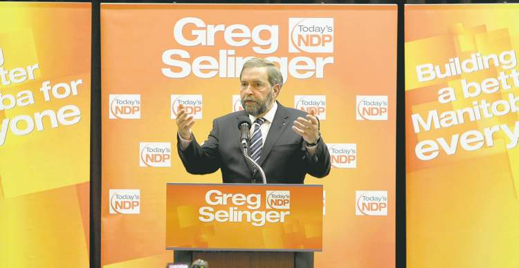 Federal NDP Leader Thomas Mulcair received a standing ovation for his position on the environment in a half-hour speech to about 200 convention delegates in Winnipeg.