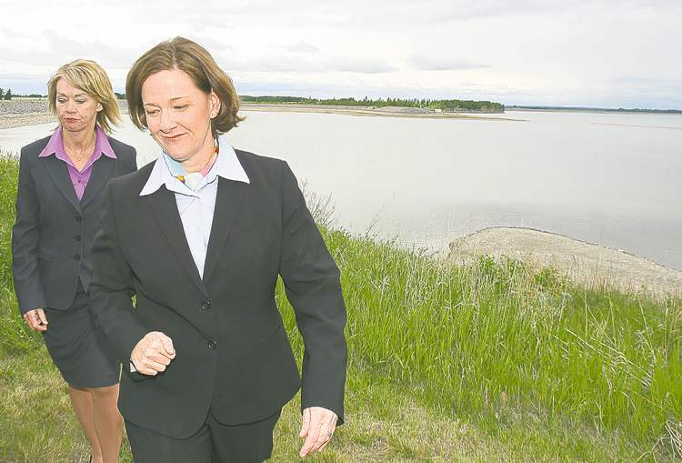 Alberta Environment Minister Diana McQueen (left) and Premier Alison Redford discuss the oil spill at nearby Dickson Dam.