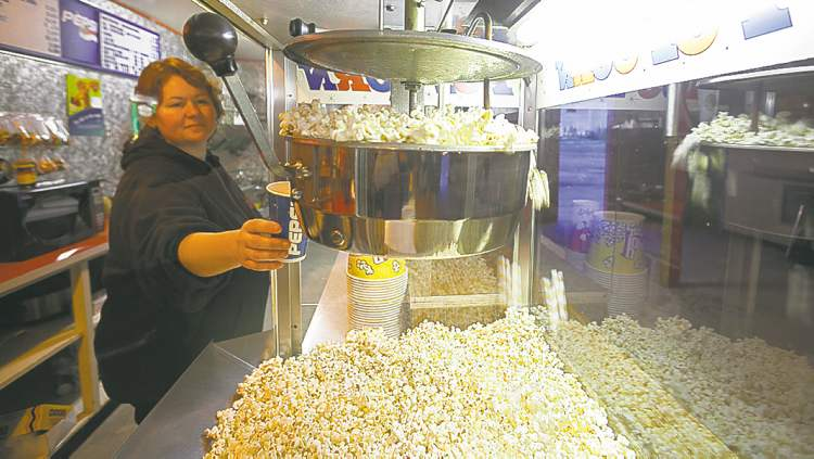 Marlene Nelson gathers some freshly made popcorn before showtime at the Stardust Drive-In in Morden. 120526 - Saturday, May 26, 2012 -  Melissa Tait / Winnipeg Free Press
