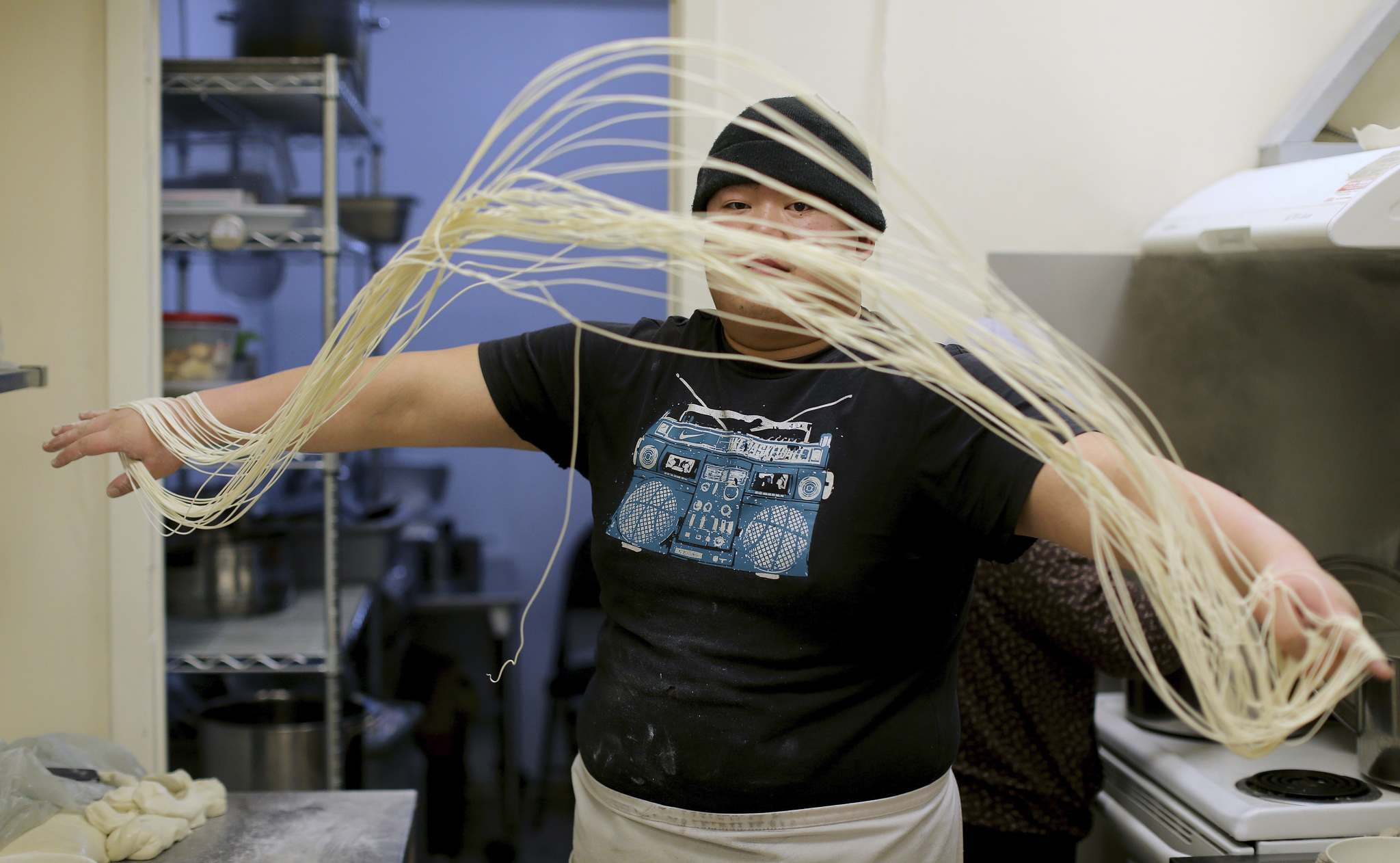 TREVOR HAGAN / WINNIPEG FREE PRESS </p><p>The name 'Dancing Noodle' is self-explanatory when you see the chef at work.</p>