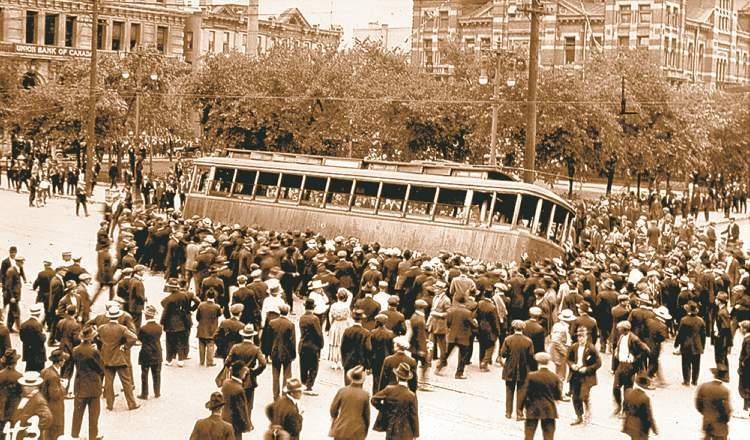 1919 Winnipeg general strike street car streetcar overturned on Main Street in front of the old City Hall building.