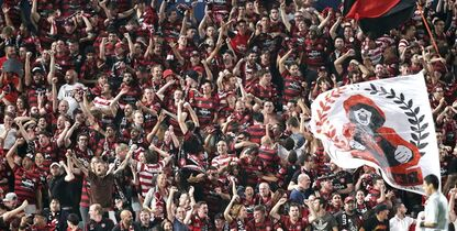Western Sydney fans dance as they celebrate after the Wanderers' scored against Saudi Arabia's Al Hilal during their Asian Champions League Final soccer match in Sydney, Australia, Saturday, Oct. 25, 2014. (AP Photo/Rob Griffith)