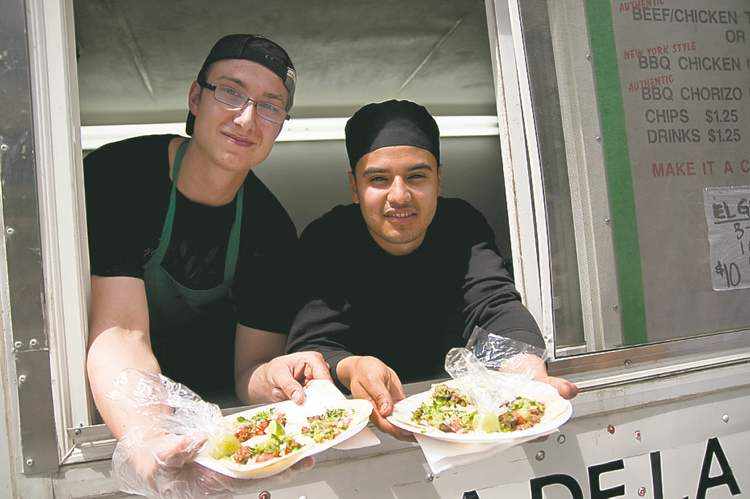 Ian Bowman (left) and Jorge Torres in their El Torrito truck. El Torrito was a hit last summer, spurring growth in the food-cart sector.