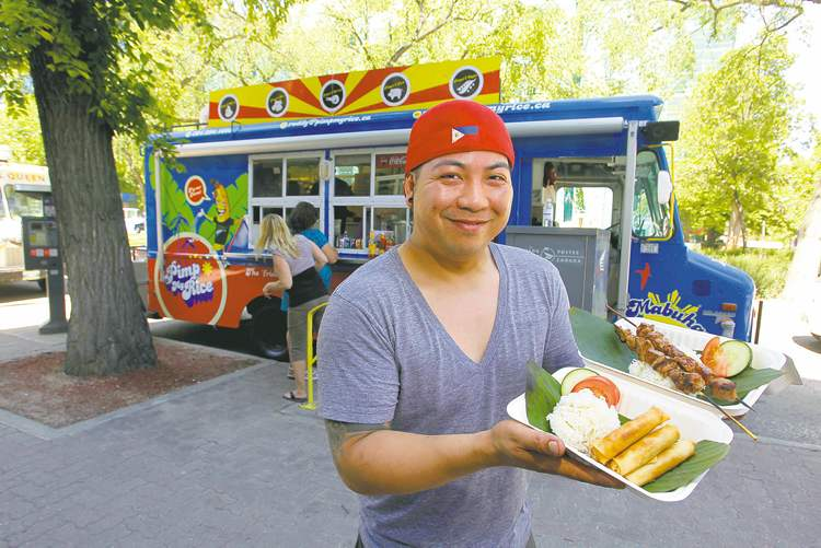 Roddy Seradilla shows his wares from Pimp My Rice on Broadway. His food truck is a childhood dream come true.