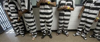 Inmate at the Saginaw County Jail, wear the new black and white jumpsuits Friday, July 18, 2014 in Saginaw, Mich. The Saginaw County Sheriff's Department has purchased the striped jumpsuits for some of the inmates at the jail. (AP Photo/The Saginaw News/MLive.com, Jeff Schrier)