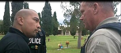 This Sept. 16, 2014 photo provided by the Cottonwwood, Ariz., Police Department shows Cecilio Cruz, left, and Cottonwood, Ariz., police Sgt. Tod Moore at a funeral home and cemetery in Tucson, Ariz., on Tuesday, Sept. 16, 2014. Cruz was arrested without incident on charges of second-degree murder and manslaughter in the 1997 death of his ex-girlfriend and her unborn child in Cottonwood, Ariz. A television show that featured the nearly two-decade-old killing of an Arizona teenager and her unborn baby helped lead to the arrest of Cruz, her ex-boyfriend, police said Wednesday, Sept. 17, 2014. Cruz was taken into custody early Tuesday in Tucson on charges of second-degree murder and manslaughter. Police in the city of Cottonwood, about 100 miles north of Phoenix, said Cruz fatally shot 17-year-old Marisol Gonzalez in the face on March 25, 1997. (AP Photo/Cottonwwood Police Department)