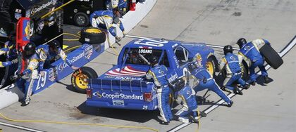 Joey Logano (29) gets service in the pit during a NASCAR Truck race at Martinsville Speedway, Saturday, March 28, 2015, in Martinsville, Va. (AP Photo/Steve Helber)