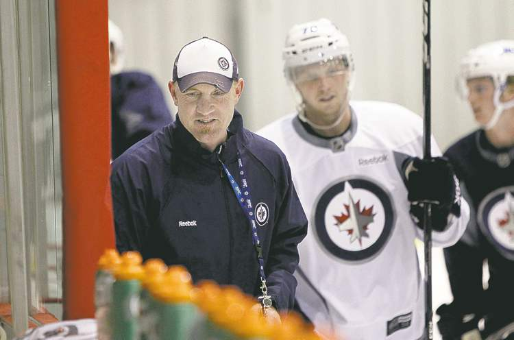 photos by mike deal / winnipeg free pressWinnipeg Jets opened their development camp at the MTS Iceplex Monday. Jimmy Roy, the Jets� co-ordinator of player development, leads the workout during the afternoon development camp.
