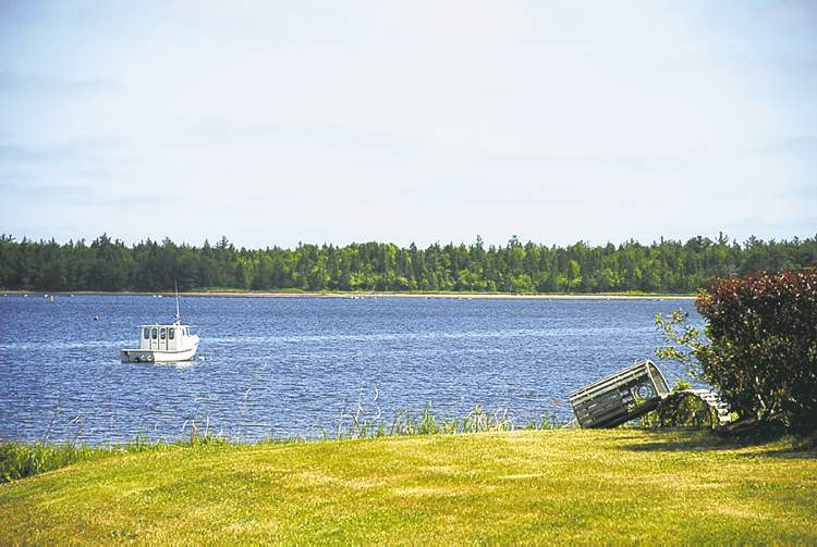 Family cottage is less than 500 metres from the beach. At left, the beach in Richibucto.