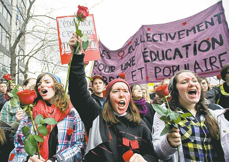 Montreal students demonstrate for women's rights and against tuition fee hikes.