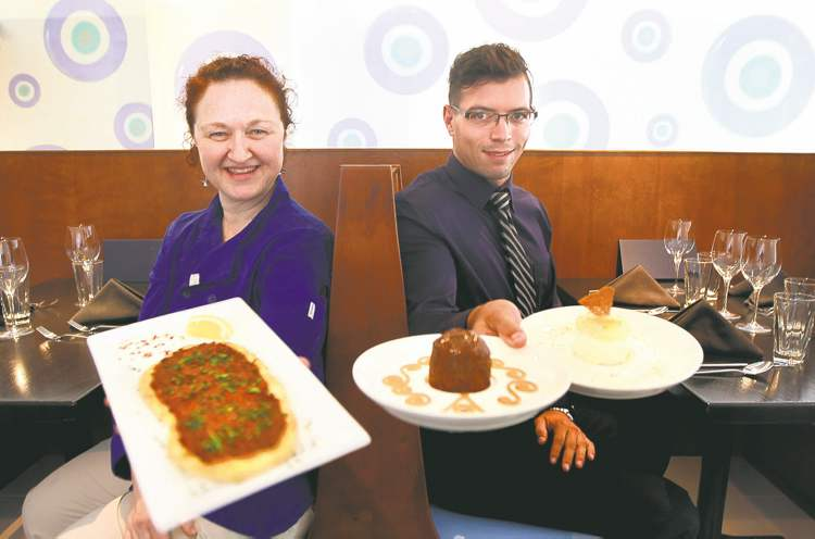 Arkadash chef Karen Peters with lahmacun; her cousin, co-owner Kelvin Peters, holds fig mecnun (left) and fleurette d'orange.