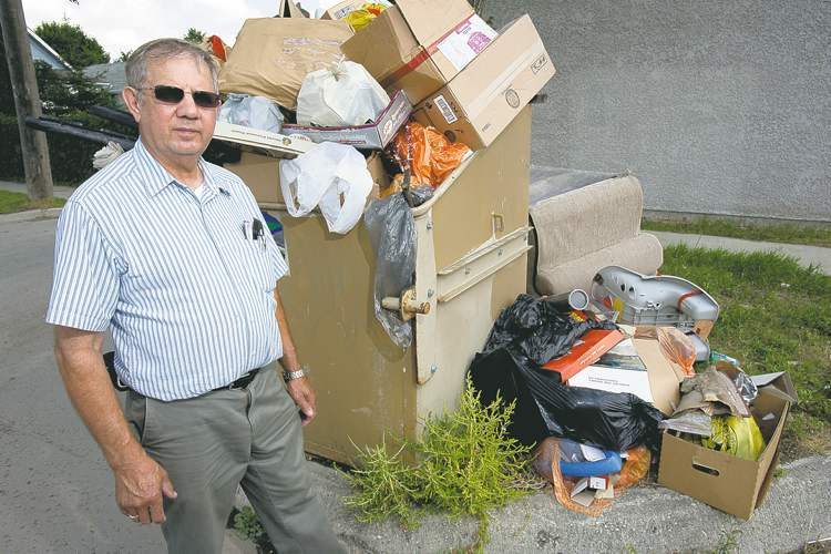 'We're like a Third World country in the North End now. The city should be picking it up. I don't care if they're removing them, the bin is full' -- Rick Negrych. (COLE BREILAND / WINNIPEG FREE PRESS)