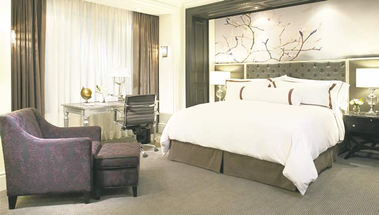 A cherry motif sets off the king-sized bed in this well-appointed Trump International Hotel room.