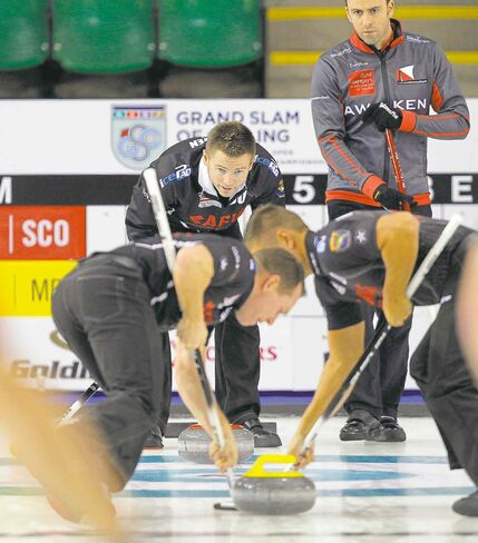 Skip Mike McEwen (top left) barks instructions to his sweepers during Wednesday's 10-3 victory over Scotland's David Murdoch.