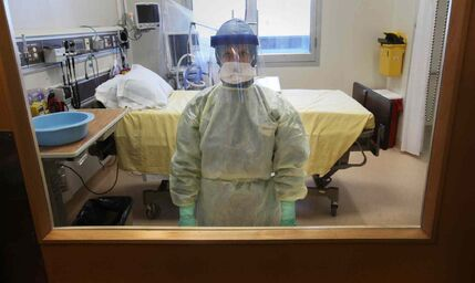 The Health Sciences Centre has prepared 10 isolation rooms which could be used to treat patients suspected of being infected with the Ebola virus. Nurse Lori Fleetwood displays the personal protective equipment health-care workers will use.