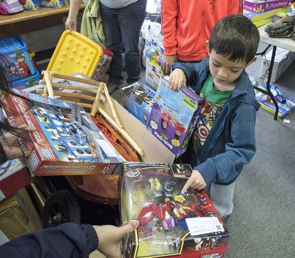 Rosco Martin, 5, choses a toy at the final sale of the Canadian Toy Testing Council on Saturday, April 18, 2015. Founded in 1952, the CTTC provided independent assessments of quality and educational enhancement for toys; it closes in 2015 due to a lack of funding. THE CANADIAN PRESS/Justin Tang