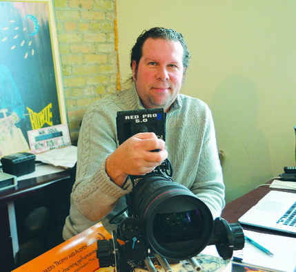 Filmmaker Jeremy Torrie shows off his RED digital camera, one piece of equipment students can expect to learn about in his classes at the Adam Beach Film Institute. He'll be teaching a workshop during this week's Winnipeg Aboriginal Film Festival.