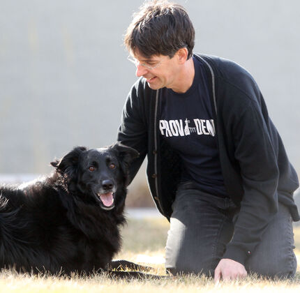 Michael Gilmour, with his dog, is a professor at Providence University who has been appointed Fellow at Oxford Centre for Animal Ethics.