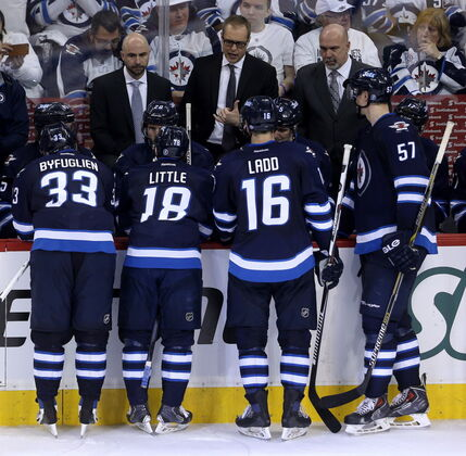 Winnipeg Jets head coach Paul Maurice instructs the team during a timeout while playing against the Anaheim Ducks during the third period of Game 3.
