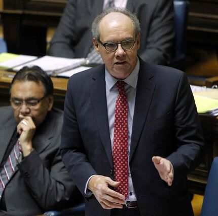 Manitoba Finance Minister Greg Dewar takes the floor during question period at the legislature in this November 2014 photograph.