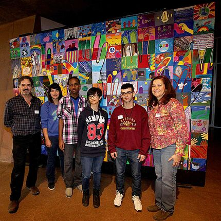 (From left) WSD art consultant Joe Halas, Daniel MacIntyre students Sumer Elk, Wali Korane, Anabelle Salonga, Hayder Al-Saeedi and art teacher Robyn Rypp in front of the Everybody has the Right mural at CMHR.