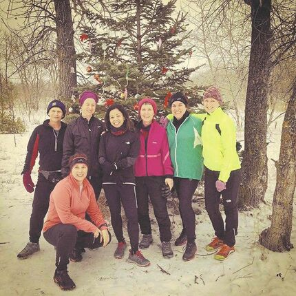 Team Turtle on a run in Birds Hill Park with a Christmas tree found along the way. Similar decorations were seen in the Bois-des-Esprits. Barb Sousa, Julie O'Shea, Maria Purificacion, Joanne Noga, Jo Holmes, Keri Wizbicki, Carrie Howell (front).