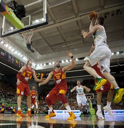 Brazil's Marcelinho Huertas, right, shoots over Spain's Marc Gasol, center, and Pau Gasol, left, during the Group A Basketball World Cup match between Brazil and Spain in Granada, Spain, Monday Sept. 1, 2014. The 2014 Basketball World Cup competition will take place in various cities in Spain from Aug. 30 through to Sept. 14. (AP Photo/Daniel Tejedor)