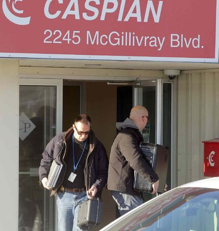 RCMP remove computer equipment from Caspian  Construction Wednesday.