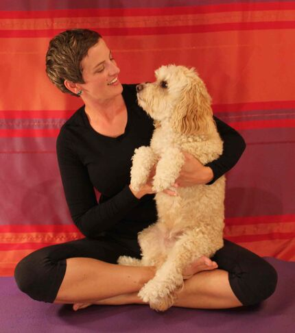 Lorna Robertson, owner of Thrive Pets, has begun practising yoga for dogs, or