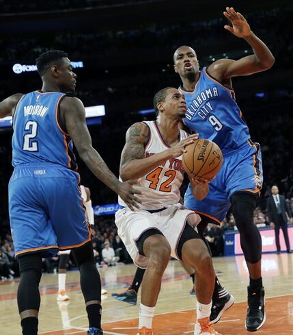 New York Knicks forward Lance Thomas (42) goes to the basket against Oklahoma City Thunder forward Serge Ibaka (9) and guard Anthony Morrow (2) during the second half of NBA basketball game, Wednesday, Jan. 28, 2015 at Madison Square Garden in New York. The Knicks won 100-92. (AP Photo/Mary Altaffer)