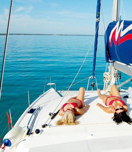 Sunbathing on the catamaran.