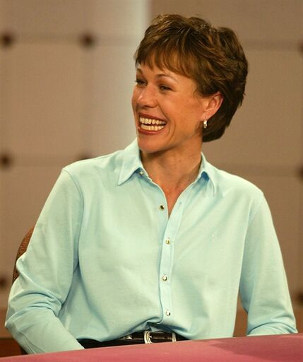 FILE - In this Tuesday, Dec 3, 2002, file photo, Suzy Whaley smiles while on the set of Golf Central at the Golf Channel in Orlando, Fla. More than one decade after becoming the first woman to qualify for a PGA event in 58 years, Whaley became the first female officer in the PGA of America's history, when the organization elected her as secretary, on Saturday, Nov. 22, 2014. (AP Photo/Rick Fowler)