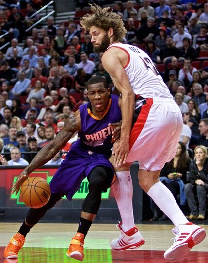 Phoenix Suns guard Eric Bledsoe, left, collides with Portland Trail Blazers center Robin Lopez, right, during the first half of an NBA basketball game in Portland, Ore., Monday, March 30, 2015. (AP Photo/Craig Mitchelldyer)