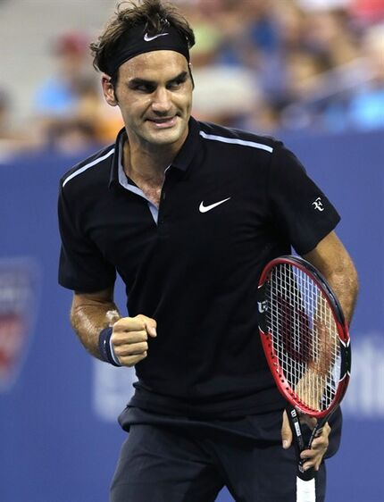 Roger Federer, of Switzerland, pumps his fist after winning the second set against Roberto Bautista Agut, of Spain, during the fourth round of the 2014 U.S. Open tennis tournament, Tuesday, Sept. 2, 2014, in New York. (AP Photo/Charles Krupa)