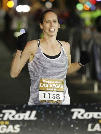 Cathy Cullen nears the finish line to be the first female finisher at the Rock 'n' Roll Las Vegas Marathon along the Las Vegas Strip on Sunday.