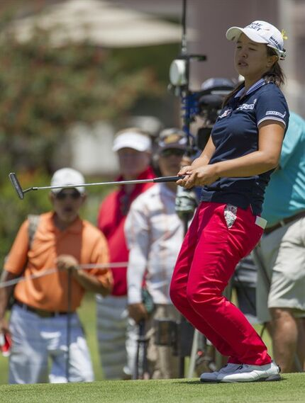 Sei Young Kim of South Korea reacts to missing a putt on the second green in the final round of the LPGA Lotte Championship golf tournament at Ko Olina Golf Club, Saturday, April 18, 2015, in Kapolei, Hawaii. (AP Photo/Eugene Tanner)