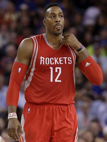 Houston Rockets center Dwight Howard walks on the floor during the second half of an NBA basketball game against the Golden State Warriors in Oakland, Calif., Wednesday, Jan. 21, 2015. The Warriors won 126-113. (AP Photo/Jeff Chiu)