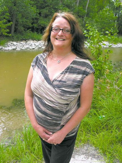 School trustee candidate Carlene Rummery is pictured by the Seine River.