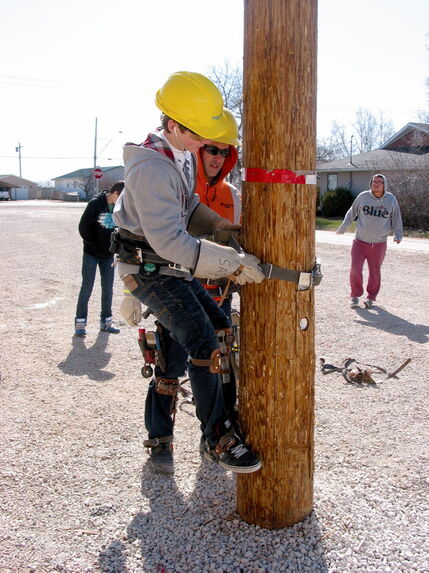 St. Paul's Collegiate student Nicholas Tjachyk tests his pole climbing skills under the supervision of Manitoba Hydro's Dan Robitaille on May 9.
