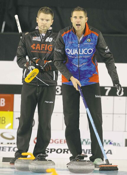 Skip Mike McEwen (left) dropped a 5-3 decision to Calgary's John Morris during Friday's action in Selkirk.
