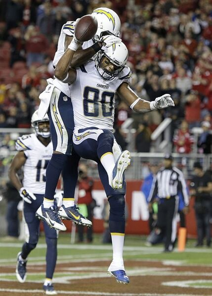 San Diego Chargers wide receiver Malcom Floyd (80) celebrates after catching an 11-yard touchdown reception with wide receiver Eddie Royal during the fourth quarter of an NFL football game against the San Francisco 49ers in Santa Clara, Calif., Saturday, Dec. 20, 2014. (AP Photo/Marcio Jose Sanchez)