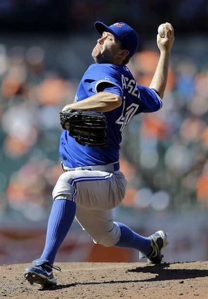 FILE - In this June 15, 2014, file photo, Toronto Blue Jays relief pitcher Casey Janssen throws to the Baltimore Orioles in the ninth inning of a baseball game in Baltimore. A person familiar with the negotiations says Janssen and the Washington Nationals have agreed to a one-year contract with an option for 2016. The person spoke to The Associated Press on condition of anonymity on Wednesday, Jan. 28, 2015, because the deal had not been announced (AP Photo/Patrick Semansky, File)